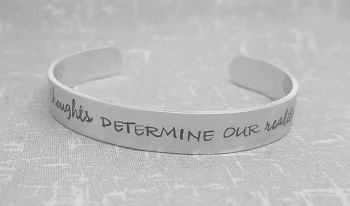 Our thoughts determine our reality Cuff Bracelet