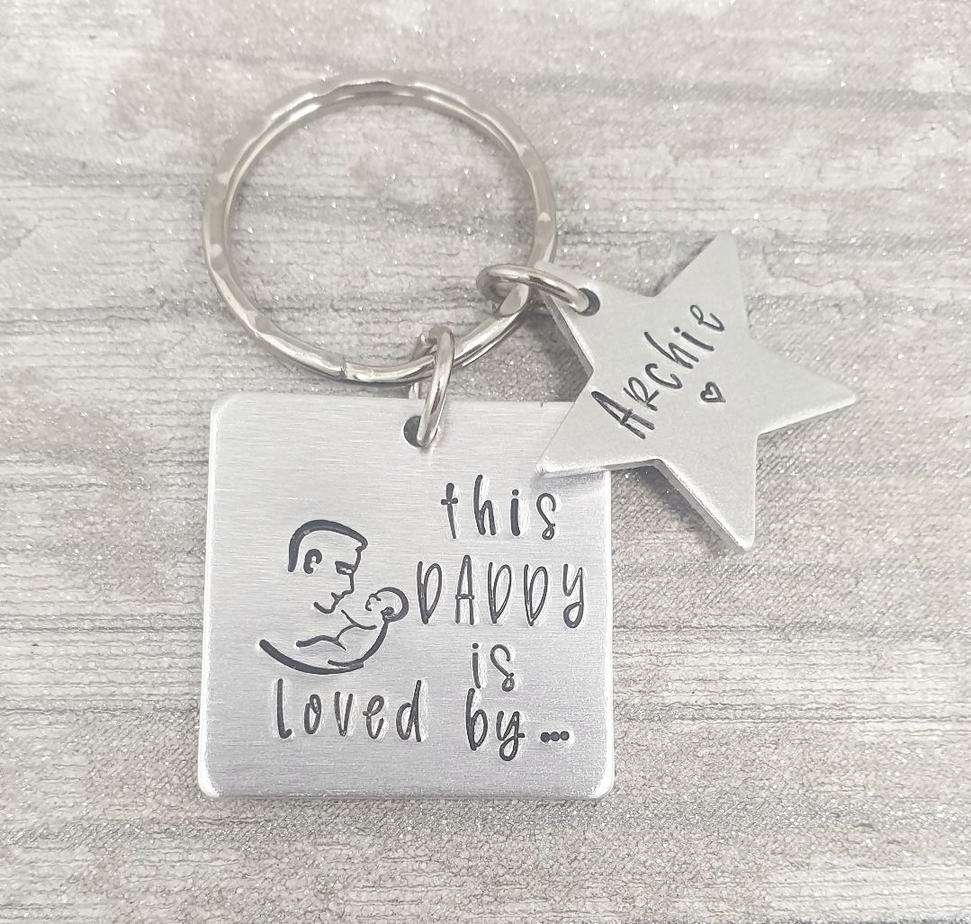 This Daddy Is Loved By.. Keyring