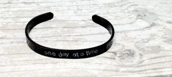 One day at a time - Cuff bracelet (black coloured)