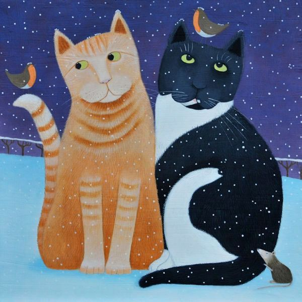 Two cats sit together with a robin on the head in the snow.
