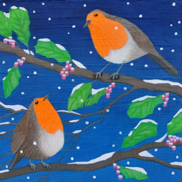 Two robins called Rupery and Roxy sit together on a branch in the snow.