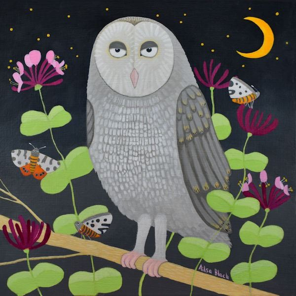 An owl rests in among honeysuckle at night time