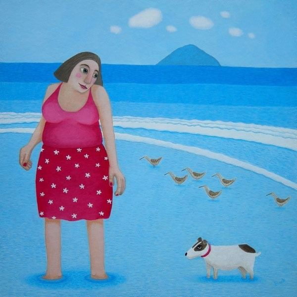 A large woman paddles in the sea with her jack russel who is a reluctant paddler.