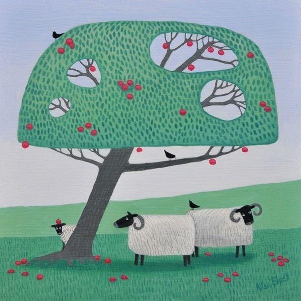 sheep grazing underneath an apple tree