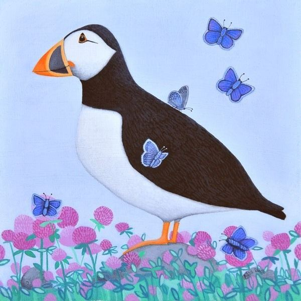A painting of a puffin on a blue background with blue butterflies and sea pink