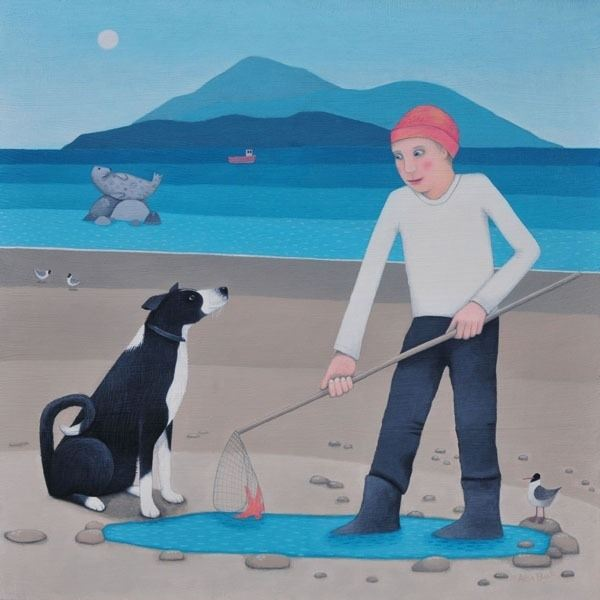 A boy and his collie dog on the beach.