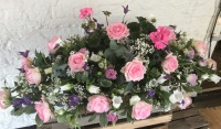 Rose and Geranium for summer/Cyclamen for winter casket spray