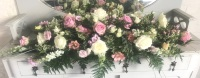 Pretty pastels white Rose casket Spray