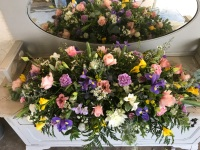 Pretty delicate brights casket spray