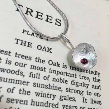 Solid silver acorn cup with garnet pendant and chain