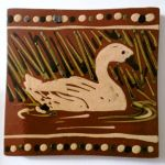 slip-trailed swan tile