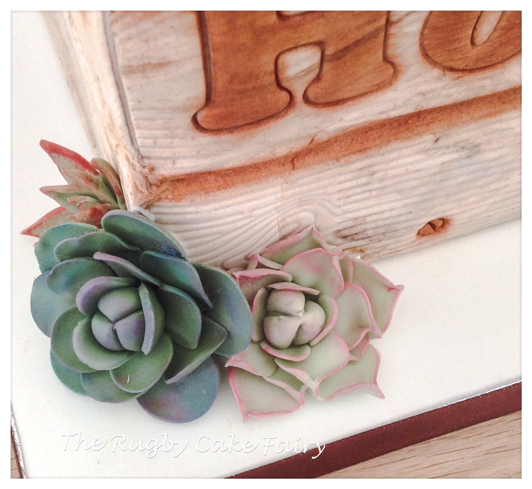 lemon crate wedding cake succulents