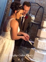 phil & kate cutting cake