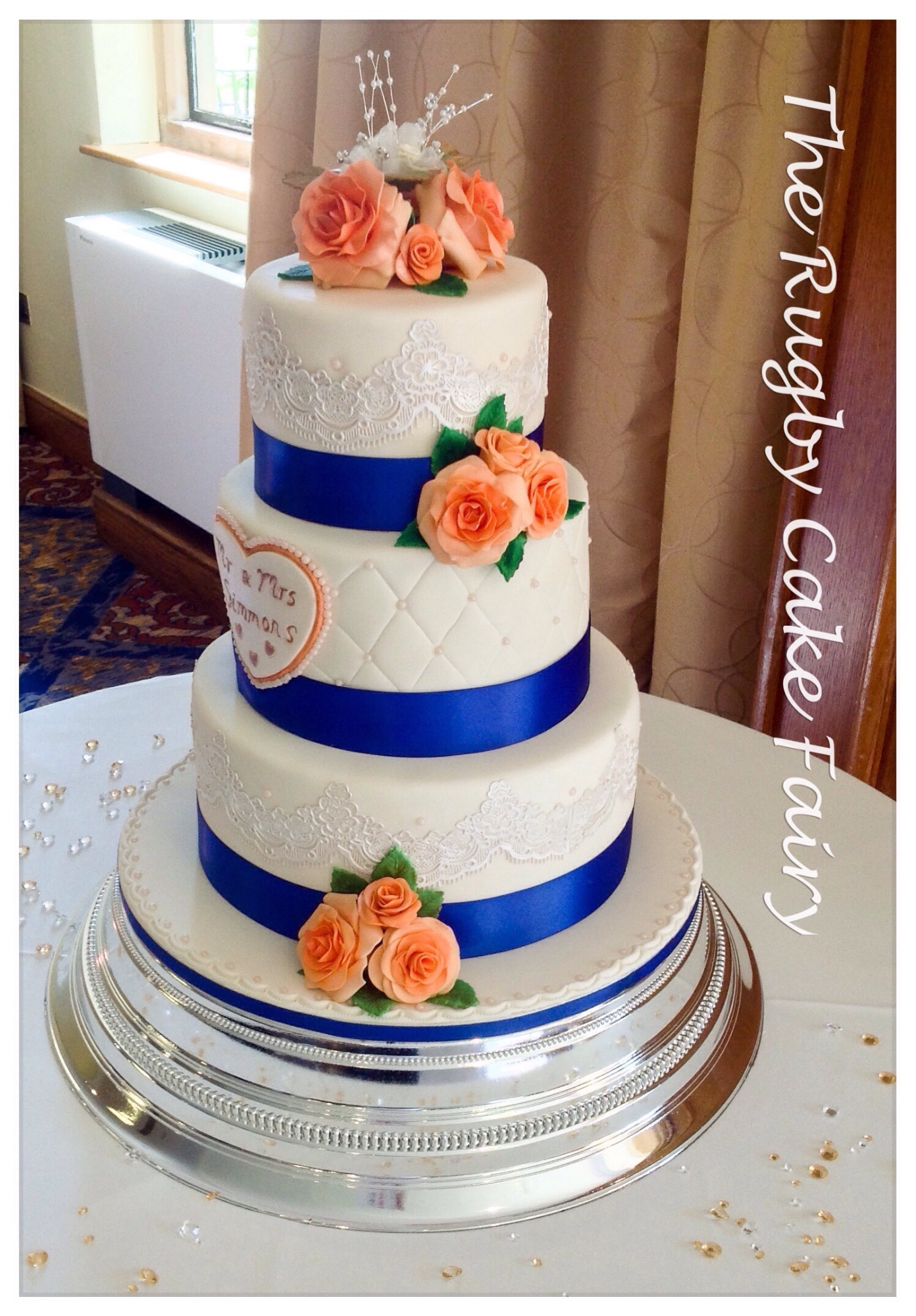 peach and lace wedding cake side view