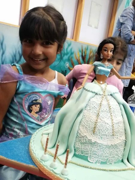 princess jasmine doll cake with girl