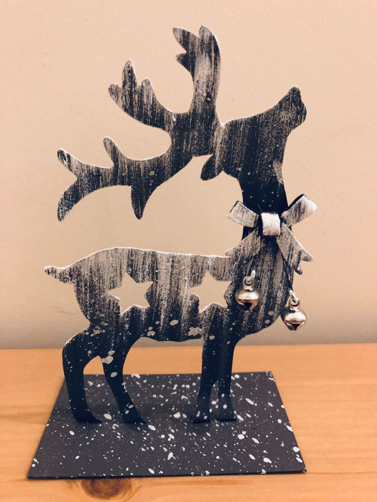 Snowy Reindeer With Bells