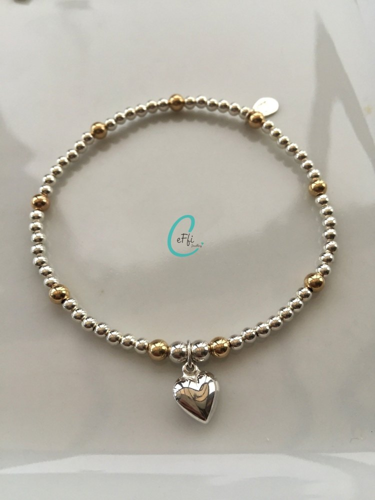 Sterling silver and gold heart stretch bracelet
