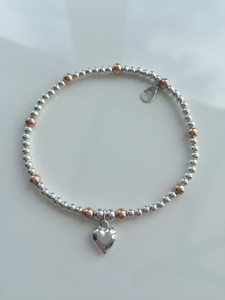 Silver an rose gold stretch bracelet | CeFfi