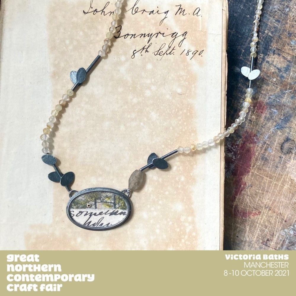 GNCCF banner and necklace with ovals