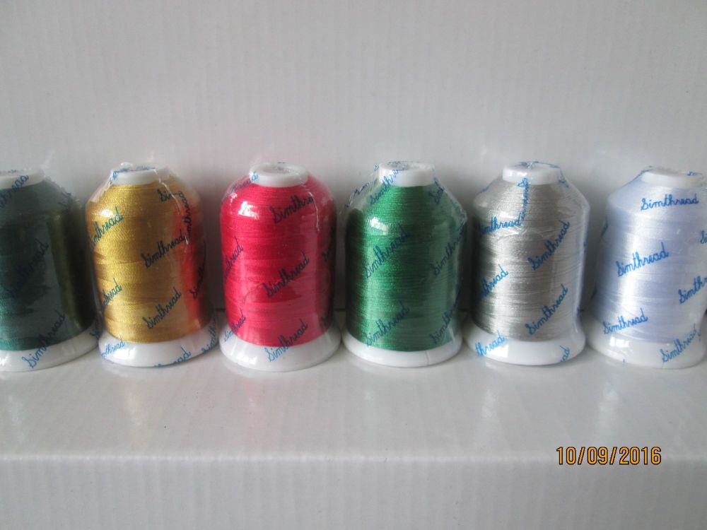 <!-- 010 --> 6 Christmas shades - 1000m polyester spools - no metallics