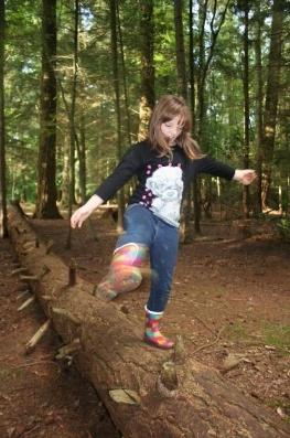 Emma balancing on pine
