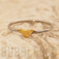 Sterling Silver Stacking Ring featuring a brass Triangular accent.