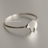 Sterling Silver Stacking Ring featuring a hand cut silver Bear accent.