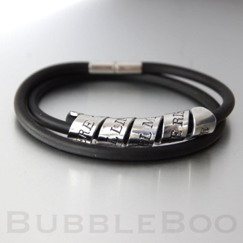 Secret Message bracelet on a double looped RUBBER strap with magnet clasp.