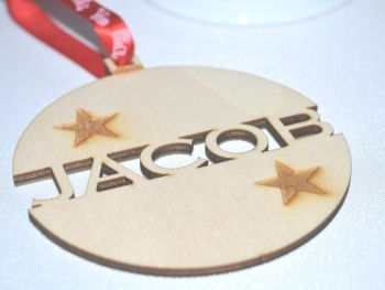 Personalised Wooden Christmas Bauble With A Star Design