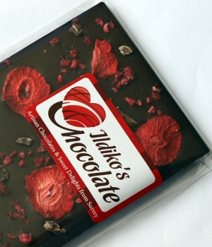 Extremley Dark Chocolate (86% Cocoa Solids and No Added Sugar) decorated with Strawberries, raspberries and organic raw cocoa nibs