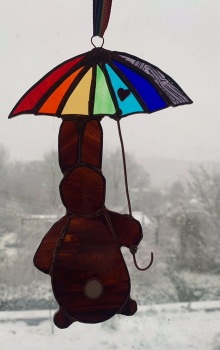 Stained glass rabbit with rainbow umbrella