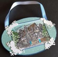 Tudor Cottage oval MDF wall hanging