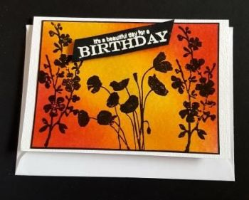 Flowers in silhouette on sunrise background C6 white card
