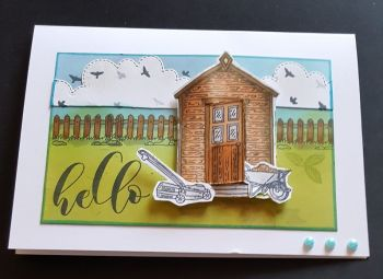 Hello! Garden shed and a sea landscape 7x5in white card