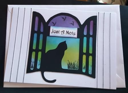 Just a note... cat silhouette in window C5 white card