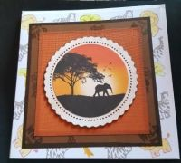 Elephant in silhouette on hand stamped 7in white card