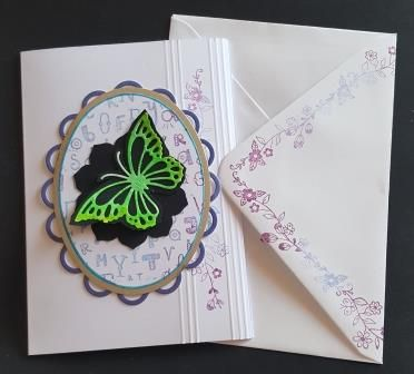 Butterfly on an oval alphabet themed background C6 white card