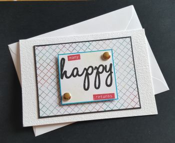 Many Happy Returns hand stamped plain A6 white card