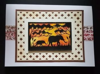 Elephants in silhouette on hand coloured background 7x5in white card