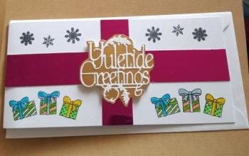 Yuletide Greetings, present style DL card