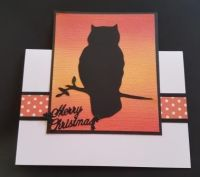 Owl in silhouette on hand coloured background Christmas card