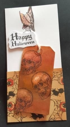 GC 2019 - Halloween - Happy Halloween Skulls on Kraft Tag with eyes behind