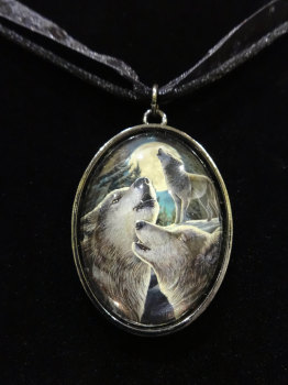 wolf song glass pendant with 20 inch black cord.