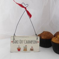 "mini ""Bake Off Champion"" sign"