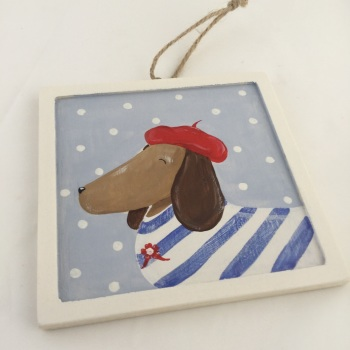 sausage dog with red beret
