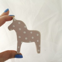 mini horse spots on pink background