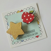 Gold star and apple brooch duo