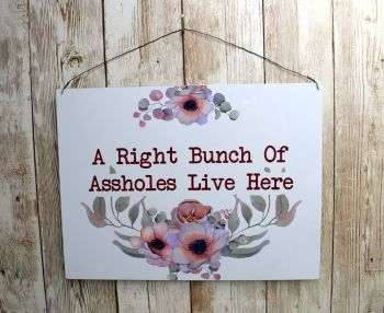 A RIGHT BUNCH OF ASSHOLES LIVE HERE SIGN