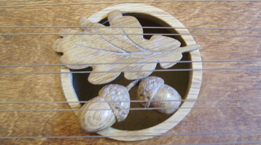 Oak soundhole insert by Manning