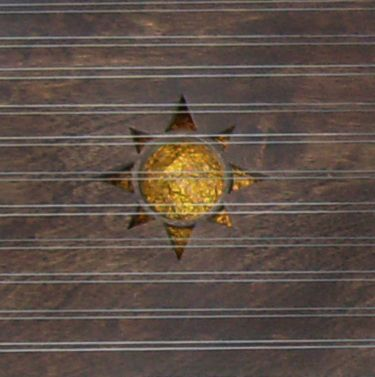 Sun soundhole by Tim Manning